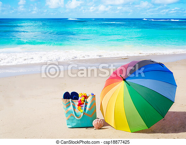 Summer background with rainbow umbrella and beach bag - csp18877425