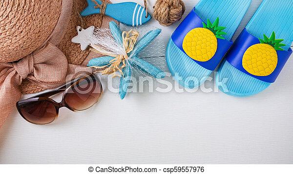 Summer beach accessories on white background, top view - csp59557976