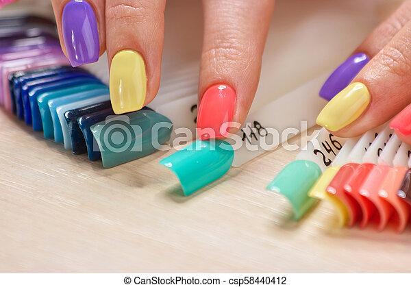 Summer bright colors female manicure.