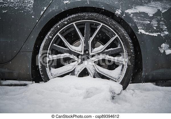Summer Car Tire Stuck in Snow - csp89394612