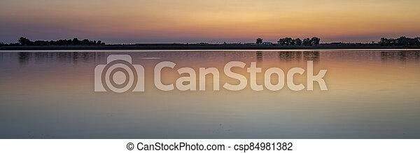 summer dawn over a calm lake - csp84981382