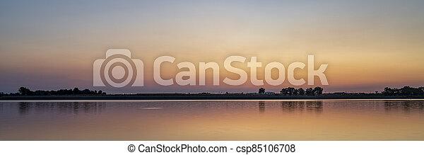 summer dawn over a calm lake - csp85106708