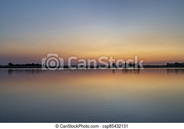summer dawn over a calm lake - csp85432131