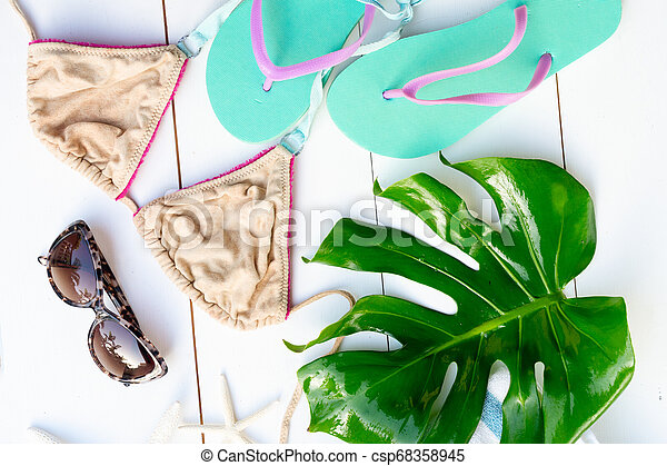 Summer flat lay scenery with swimsuit - csp68358945