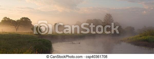 Summer foggy morning on lake - csp40361708
