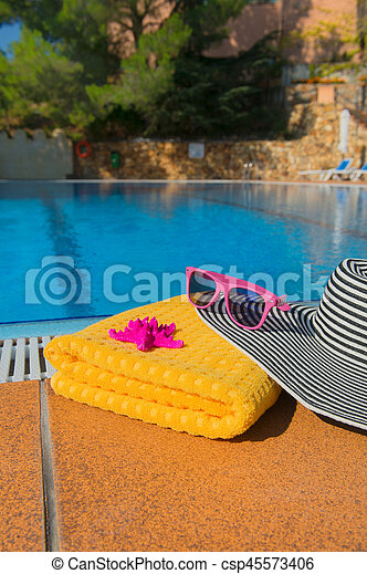 Summer hat at the swimming pool - csp45573406