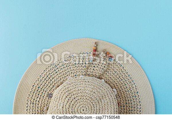 Summer hat top view on blue background - csp77150548