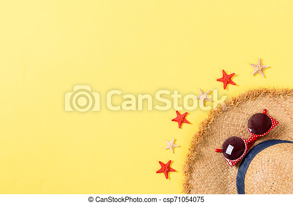summer holiday beach background with accessories on yellow table, top view with copy space. vacation concept - csp71054075