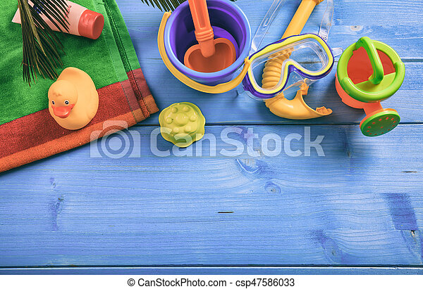 Summer kids vacation concept on blue background - top view - csp47586033