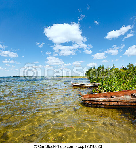 Summer lake view with wooden boats. - csp17018823