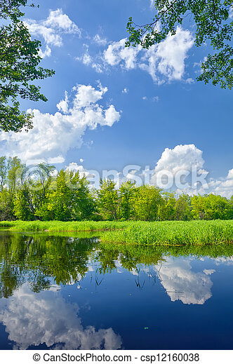 Summer landscape with Narew river and clouds on the blue sky - csp12160038