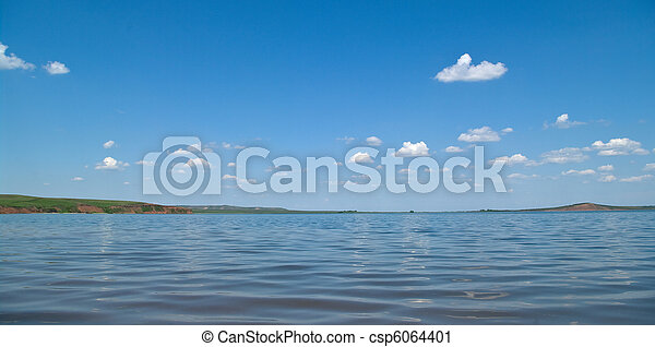 Summer landscape with quiet water of lake - csp6064401