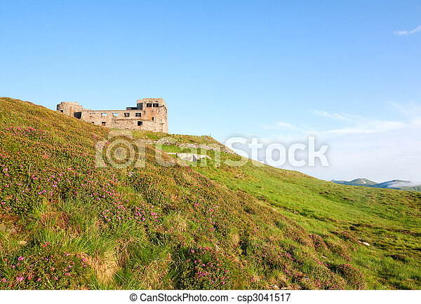 Summer mountain view with observatory ruins on mountain top - csp3041517