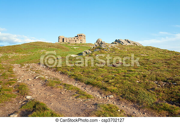 Summer mountain view with observatory ruins on mountain top - csp3702127