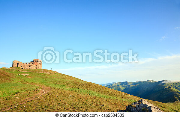 Summer mountain view with observatory ruins on mountain top - csp2504503