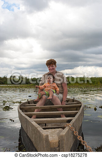 Summer on the river in a boat with a young woman sitting beautiful girl. - csp18275278