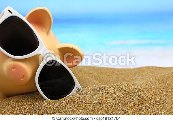 Summer piggy bank with sunglasses on the beach - csp19121784