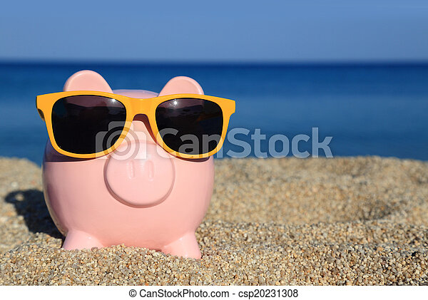 Summer piggy bank with sunglasses on the beach - csp20231308