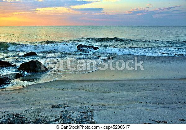 Summer Seashore Sunrise Over Rock Jetty - csp45200617