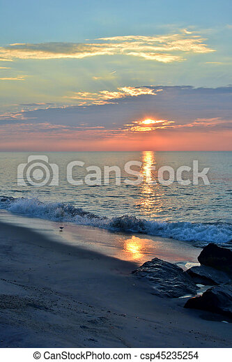 Summer Seashore Sunrise Over Rock Jetty - csp45235254