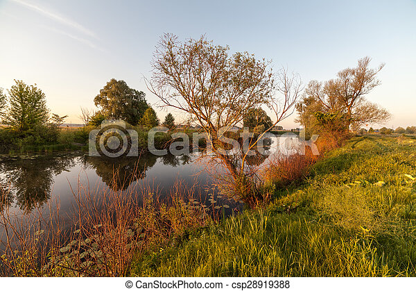 summer sunrise over the river with a fog - csp28919388
