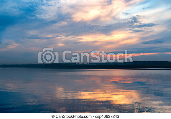 summer sunset on the shore of a lake - csp40637243