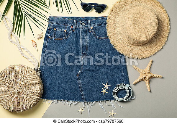 Summer vacation accessories on two tone background, top view - csp79787560