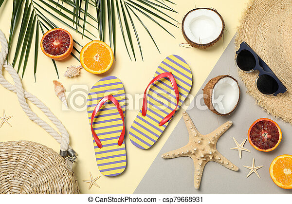 Summer vacation accessories on two tone background, top view - csp79668931