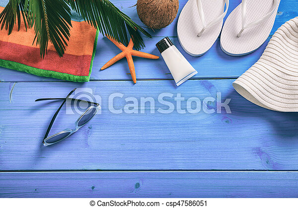 Summer vacation concept on blue background - top view - csp47586051