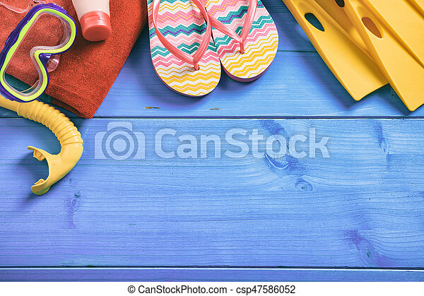 Summer vacation concept on blue background - top view - csp47586052