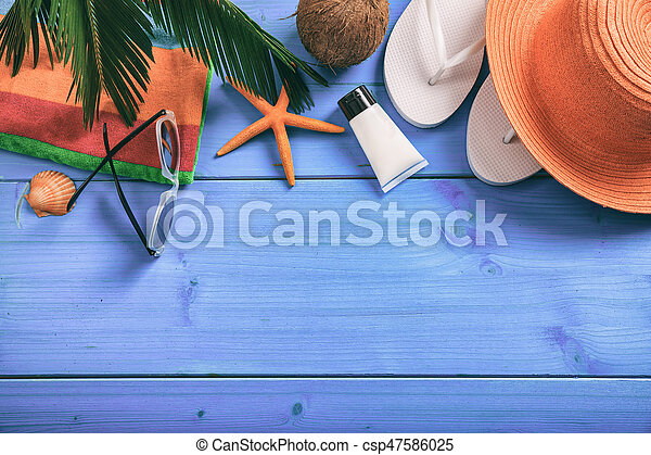 Summer vacation concept on blue background - top view - csp47586025