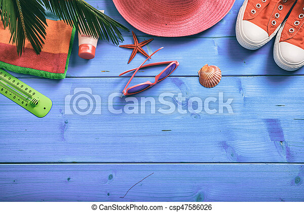 Summer vacation concept on blue background - top view - csp47586026