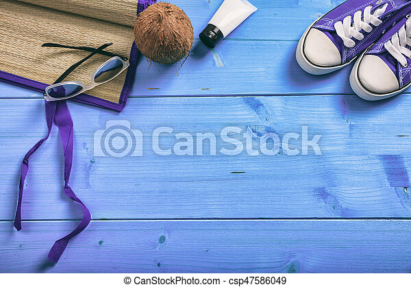 Summer vacation concept on blue background - top view - csp47586049