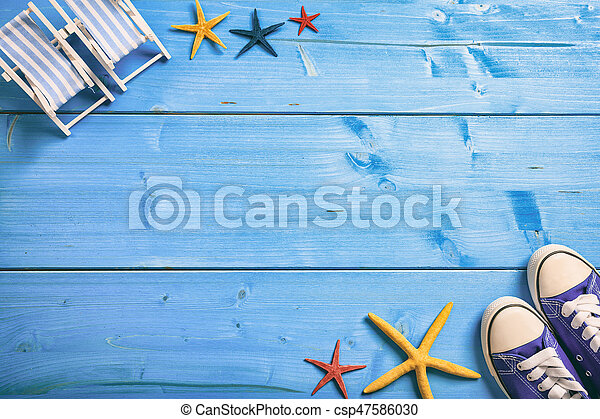 Summer vacation concept on blue background - top view - csp47586030
