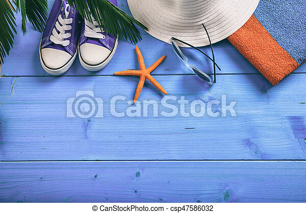 Summer vacation concept on blue background - top view - csp47586032