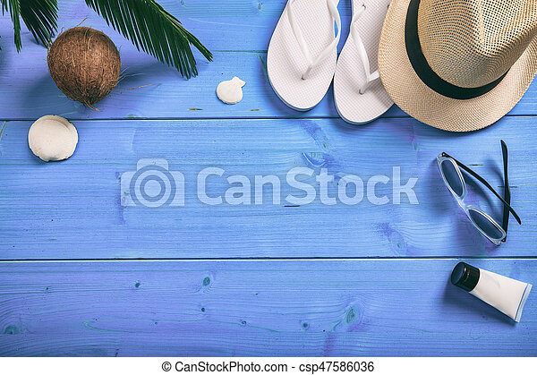 Summer vacation concept on blue background - top view - csp47586036