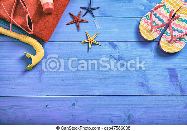 Summer vacation concept on blue background - top view - csp47586038
