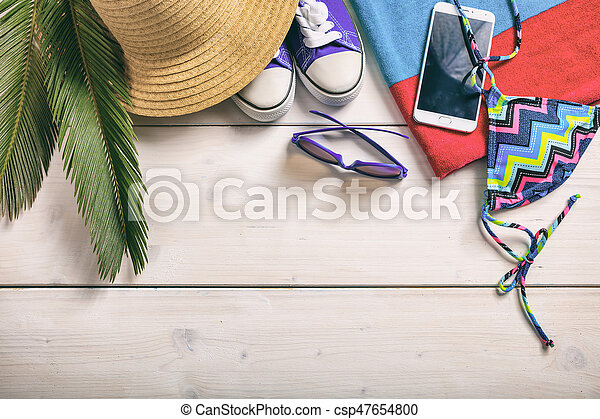 Summer vacation concept on white background - top view - csp47654800