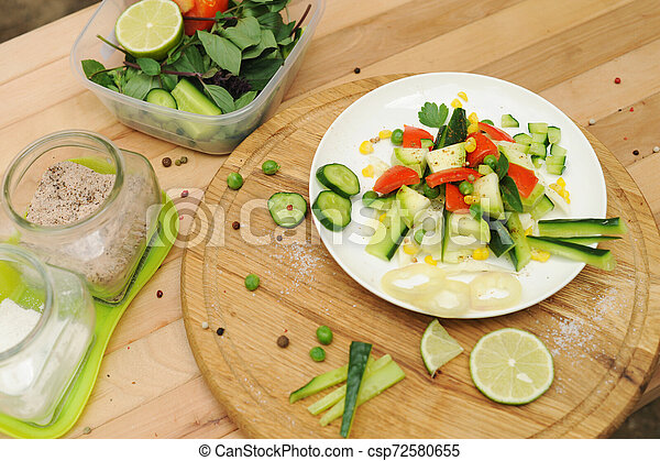 Summer vegetable salad on a plate - csp72580655