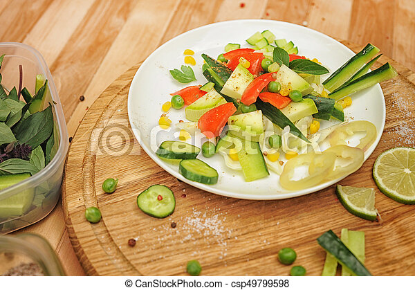Summer vegetable salad on a plate - csp49799598