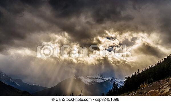 Sun breaking through Dark clouds - csp32451696
