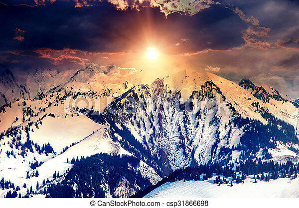 Sun in mountains on cloud sky background. - csp31866698