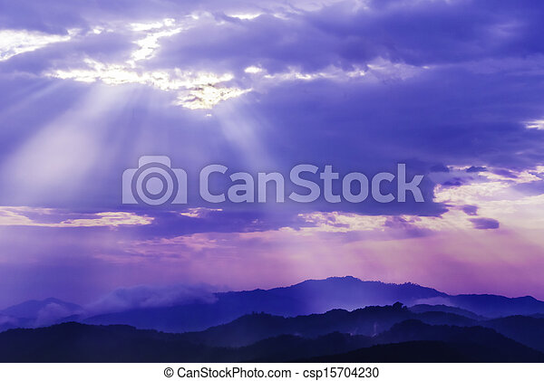 sun light through cloud sky over mountain - csp15704230