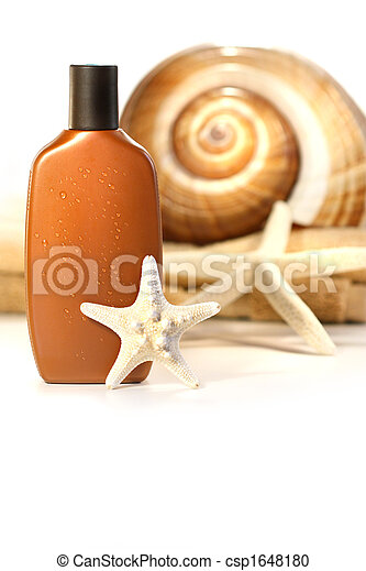 Sun lotion with seashells and towel - csp1648180