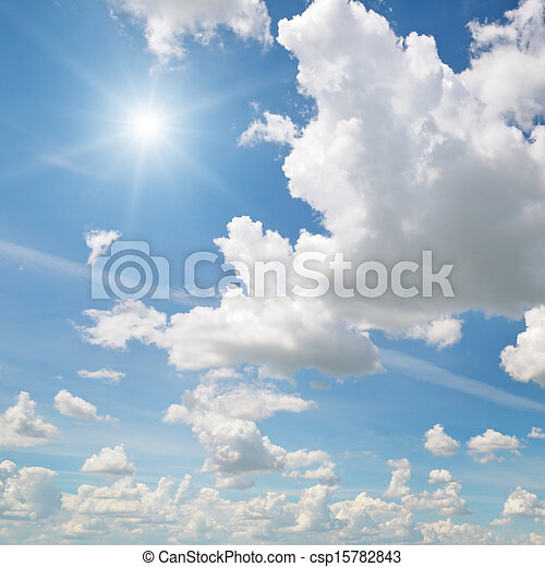 sun on blue sky with white clouds - csp15782843