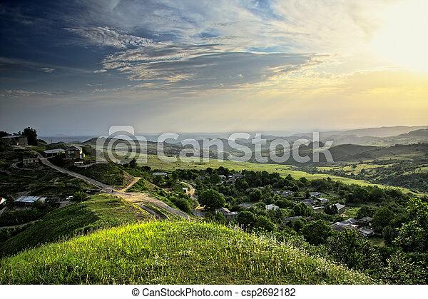 Sun over mountain countryside - csp2692182
