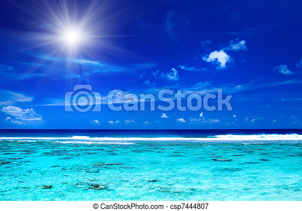 Sun over tropical ocean with vibrant colors - csp7444807