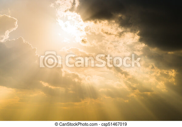 Sun rays through clouds like an dramatic explosion , power nature background.