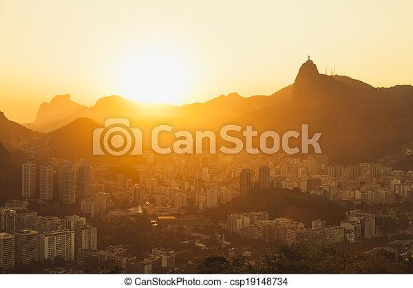 Sun setting over Rio cityscape - csp19148734