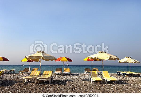 sun umbrella and chairs on a beach - csp10252994